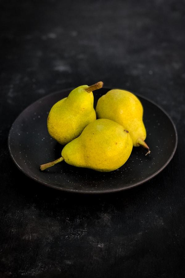 pears on dark plate