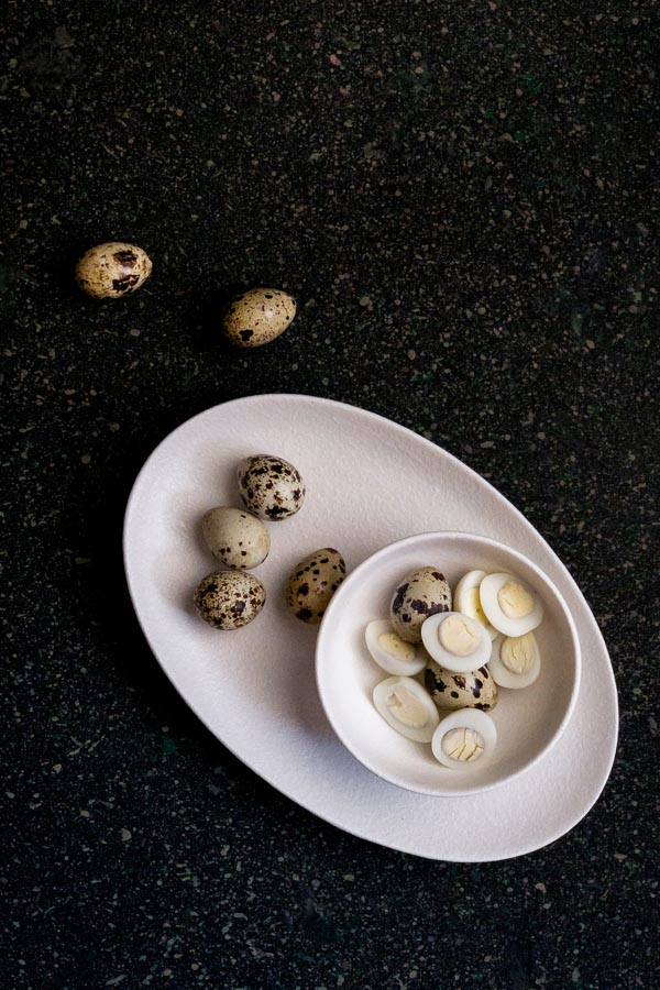 Peeled and unpeeled quail eggs for Quail Egg Salad