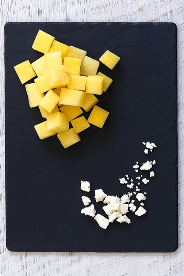 yellow watermelon in cubes with crumbly feta