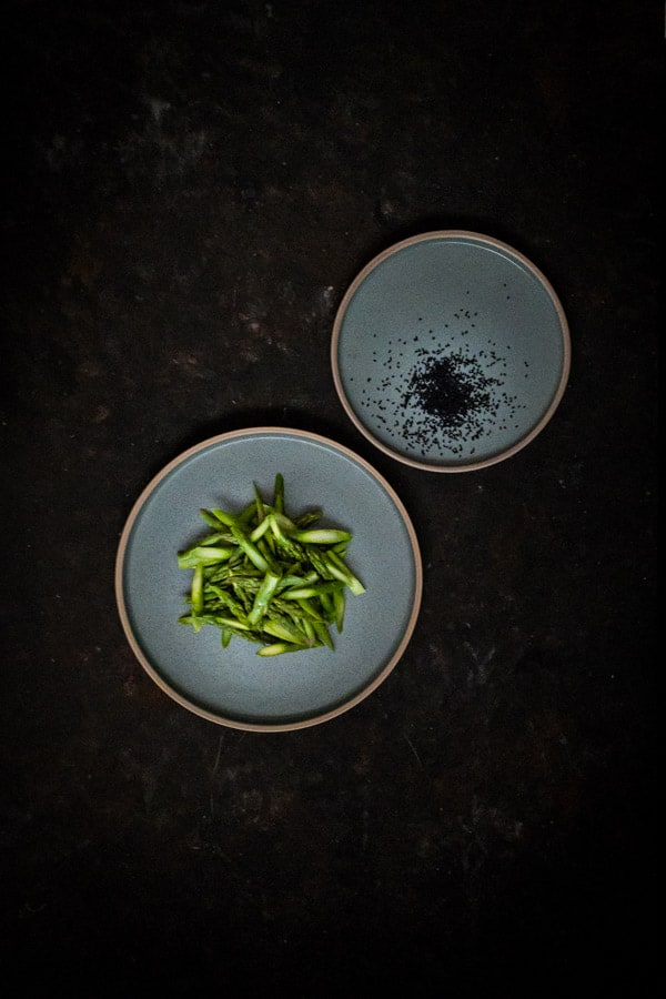 Nigella seeds and sliced asparagus