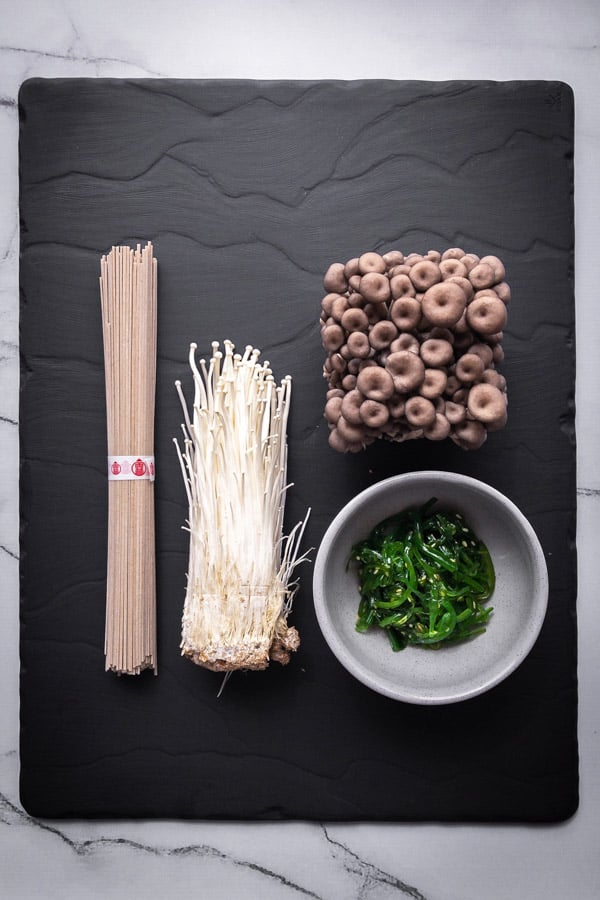 Dry soba noodle, enoki mushrooms, Japanese seaweed and shimeji mushrooms