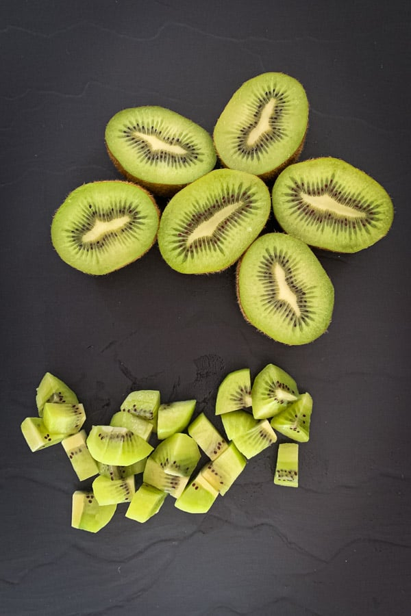 Green kiwi fruit sliced and cubed