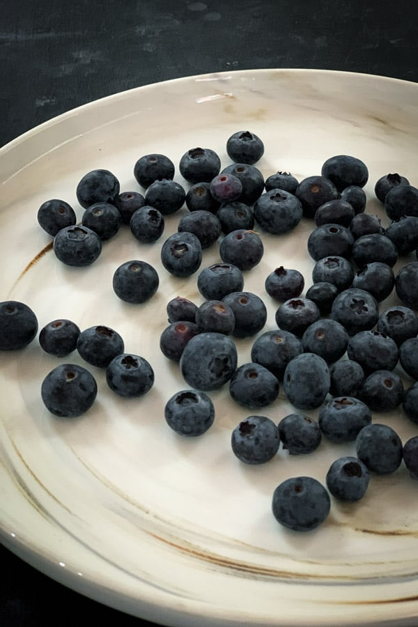 Blueberries on White Marble Plate