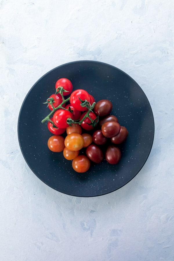 Cherry Tomatoes Red Orange Truss on a Dark Plate