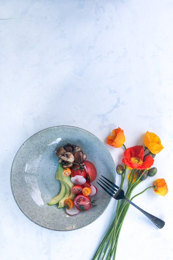 Breakfast Salad with Mushrooms, Avocado and Tomatoes with Poppies
