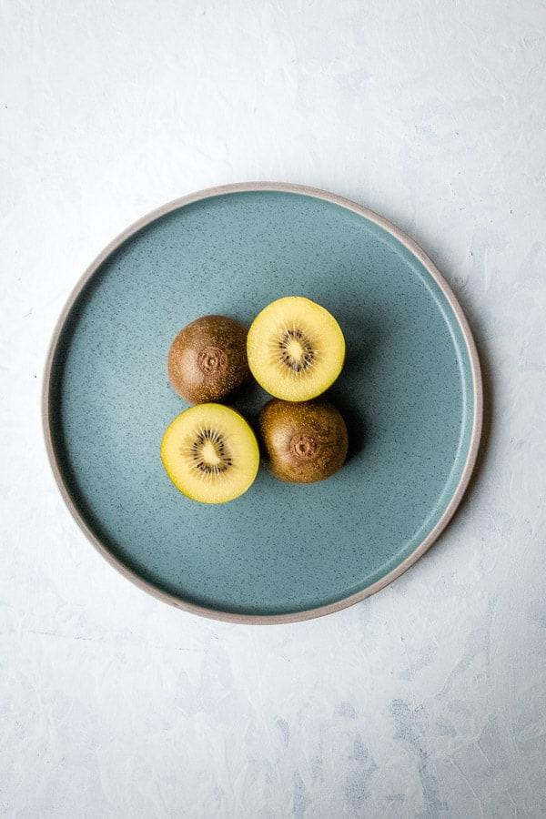 Gold Kiwi Cut Half Blue Plate