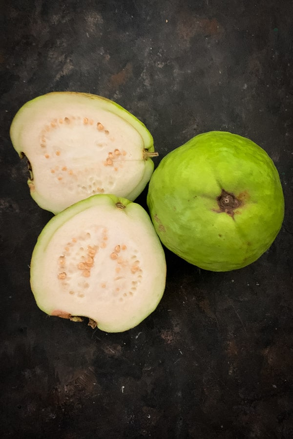 Whole and half white guava