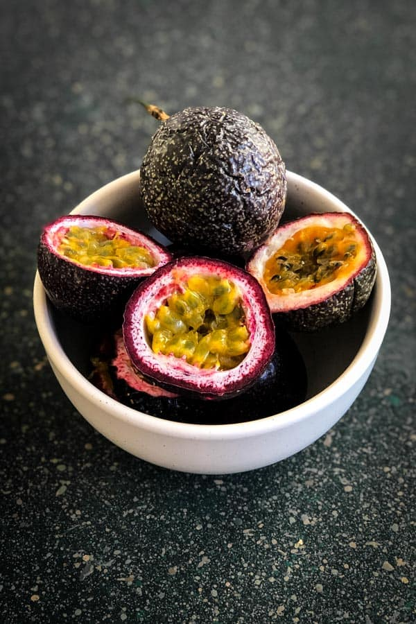 Passionfruit. Whole and halved