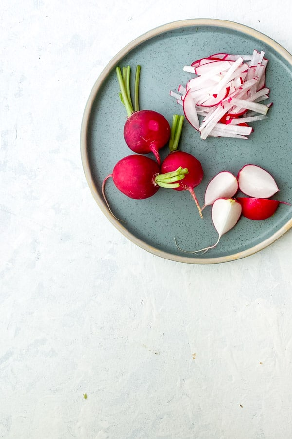 Whole and sliced radish with yuzu jam dressing