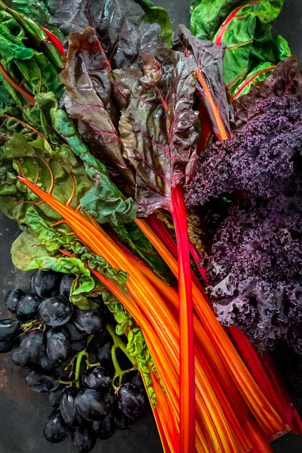Purple Kale, Rainbow Chard and black grapes