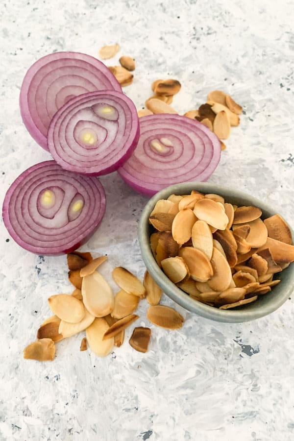 Red onions and roasted shaved almonds