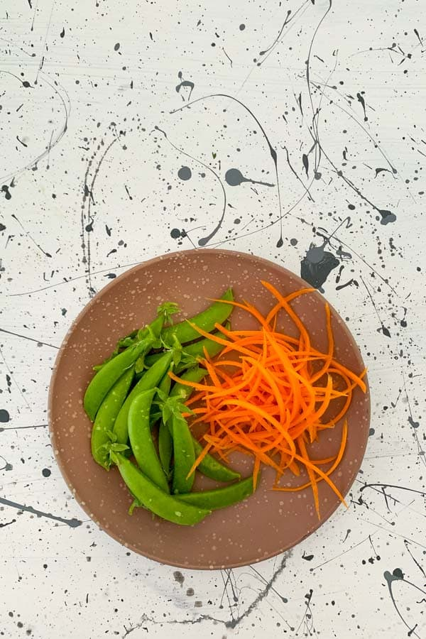 Sugar snap peas and shredded carrots