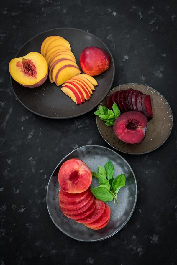 Sliced nectarines, Queen garnet plums and blood plums