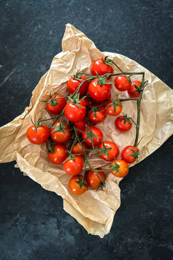 Trussed tomatoes brown paper bag