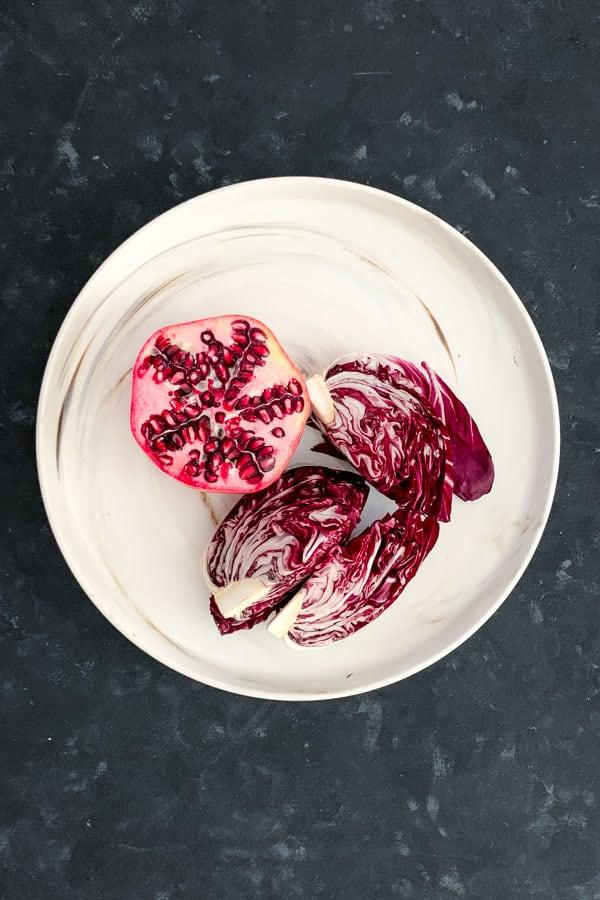 Half pomegranate and radicchio wedges