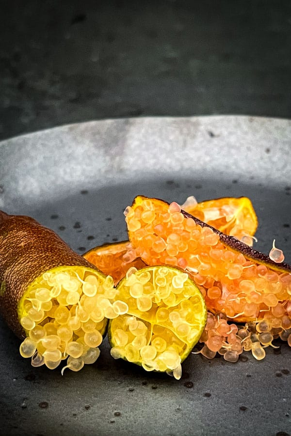 Opened Australian finger lime in yellow and orange