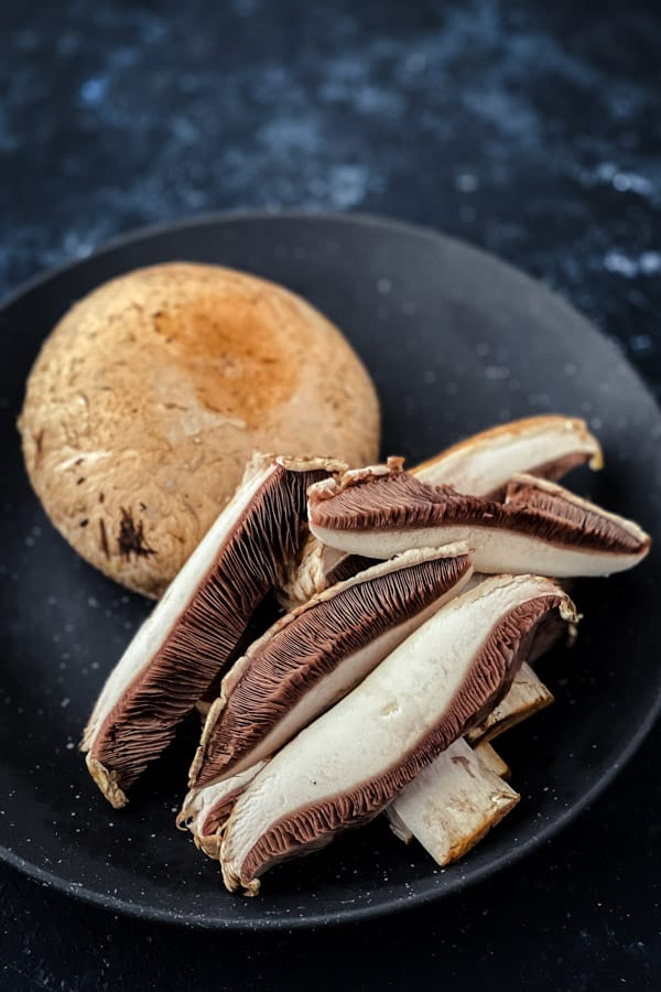 whole and sliced flat mushrooms