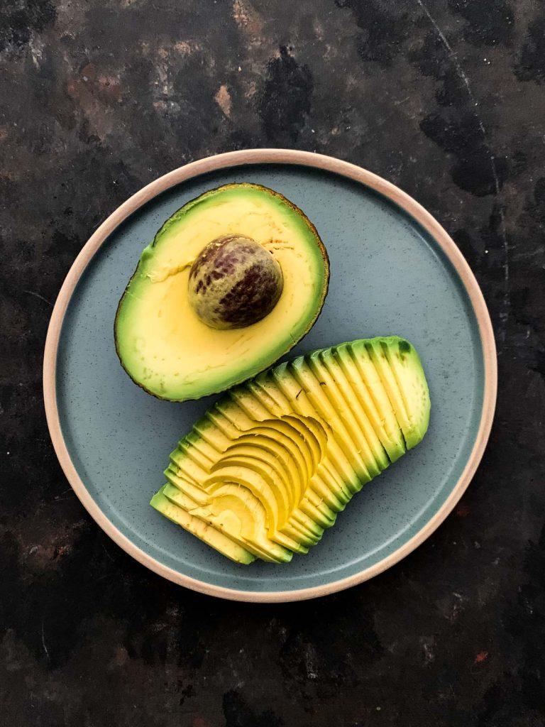 Half avocado and avocado fan