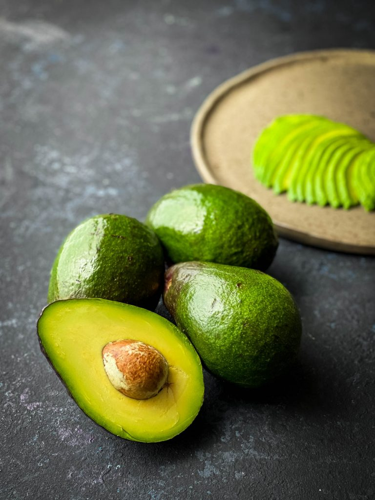 Avocado half and avocado fan