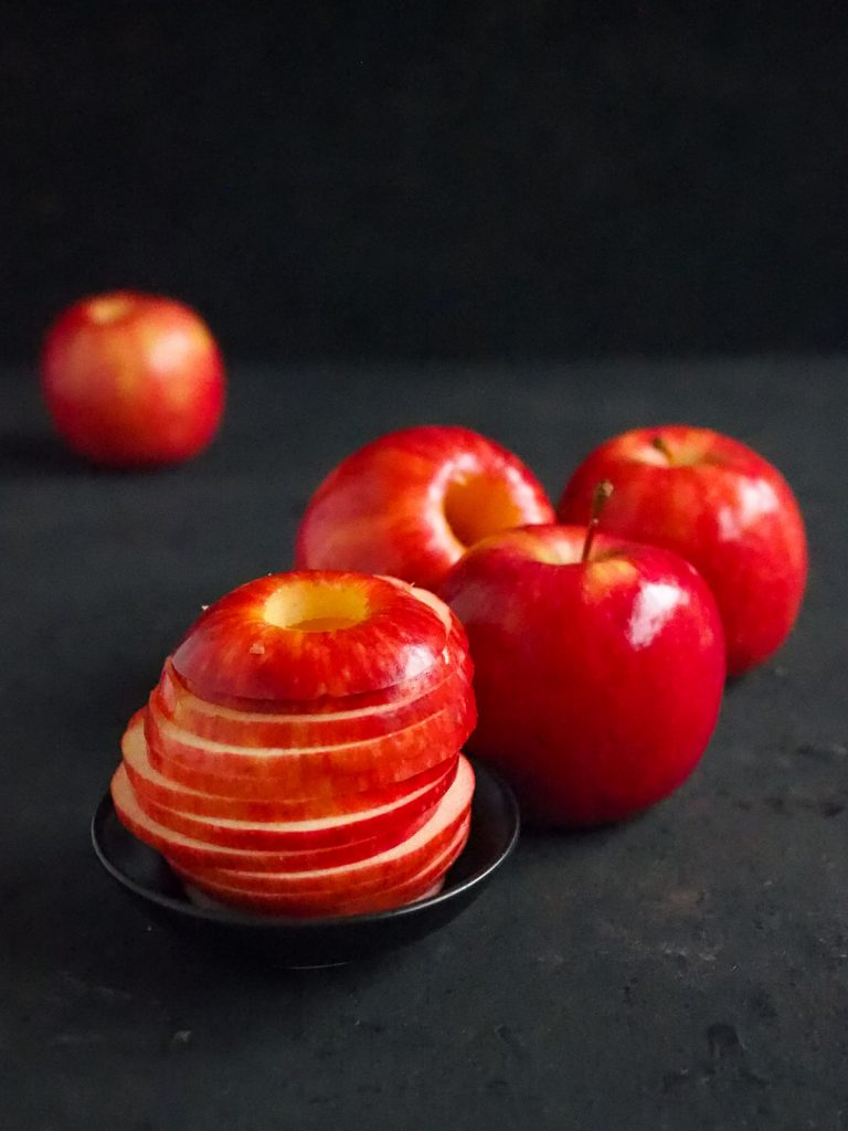 Whole apple and sliced apple