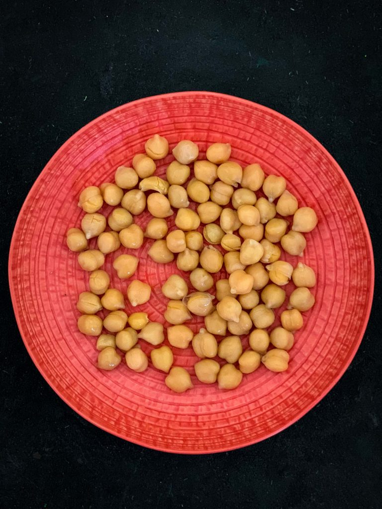 Chickpeas on a red plate