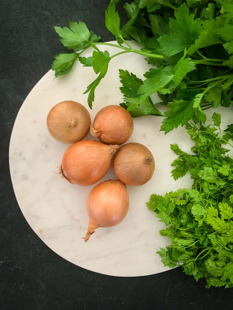 White pearl onions with chervil and flat leaf parsley