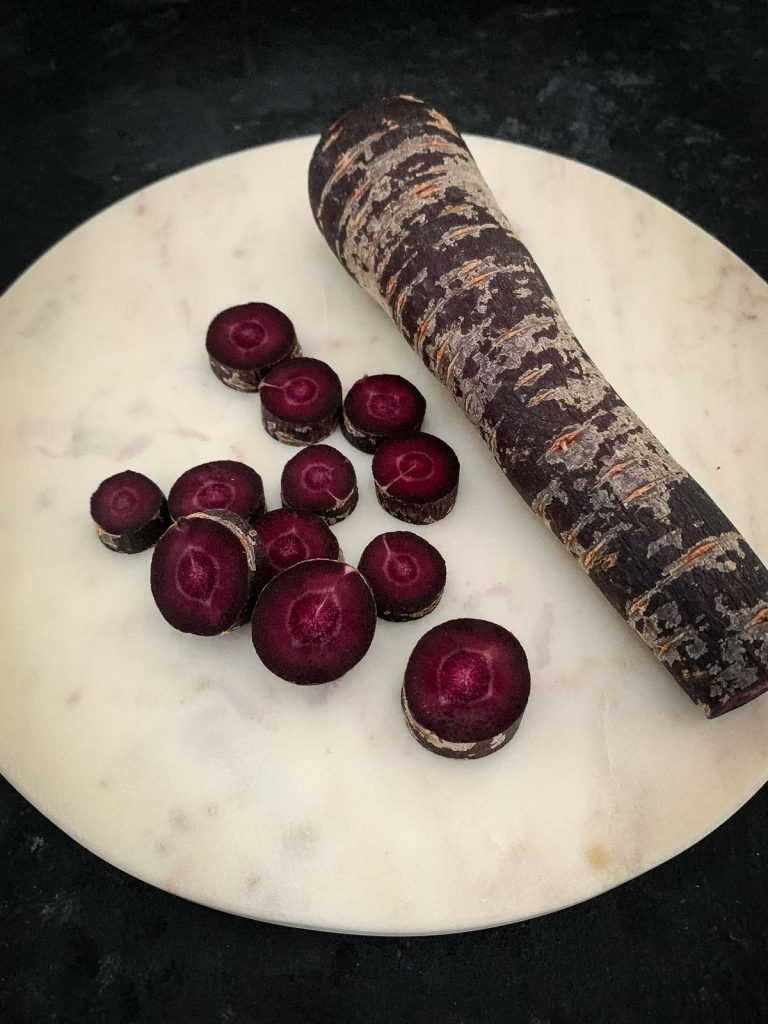 Purple carrots whole and sliced